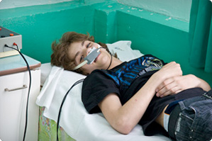 A young man undergoing treatment at Gomel Children's Hospital